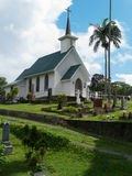 White painted small church against stormy sky Stock Images