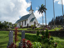 White painted small church against stormy sky Royalty Free Stock Photo