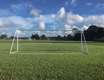 White painted soccer goalposts Stock Photo