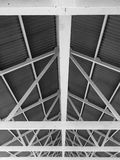Support beams under a metal corrugated roof royalty free stock photos