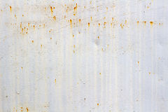 White painted surface of metal sheet with traces of corrosion. Abstract background Royalty Free Stock Photography