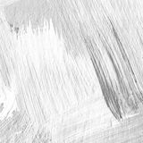White painted textured background with brush strokes. White painted textured abstract background with brush strokes in gray and black shades. Fragment of acrylic Royalty Free Stock Photography
