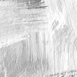 White painted textured background with brush strokes. White painted textured abstract background with brush strokes in gray and black shades. Fragment of acrylic Stock Photo
