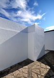 White Painted Wall. Composition of white wall and sky royalty free stock photography