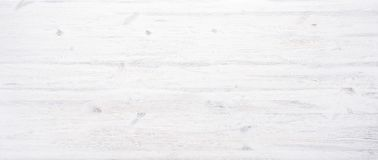 White painted wooden texture desk background table banner design header. White painted wooden desk background tabletop horizontal photo banner for website design stock photography