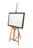 White painter canvas in frame on wooden easel isolated Royalty Free Stock Photos