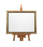White painter canvas in frame on wooden easel isolated on white Stock Images