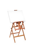 White painter canvas on wooden easel isolated on white with clip Royalty Free Stock Photo