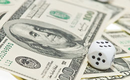 White Pair of dice on money. Pair of dice on money Royalty Free Stock Photos