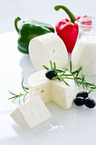 White paneer cheese with rosemary and black olives Royalty Free Stock Image