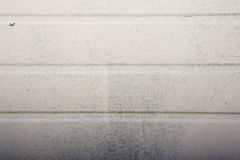 White panel texture. Dirty plastic panel can used as a background Stock Photography