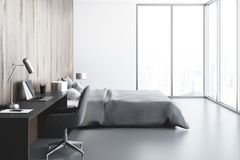 White panoramic bedroom, computer desk, side view. White and wooden panoramic bedroom interior with a concrete floor, a double bed and a magnificent window view Royalty Free Stock Photos
