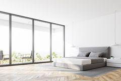White panoramic bedroom corner. Corner of a white panoramic bedroom with a wooden floor, a double bed and a magnificent window view. 3d rendering mock up Royalty Free Stock Image