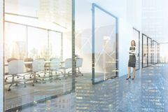 White meeting room lobby pattern side view, woman royalty free stock image