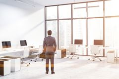 White panoramic office corner, wooden tables, man stock photos