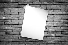 White paper. Stick tape on the gray brick wall royalty free stock images