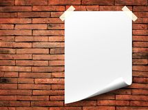 White paper. Poster paper and white paper notes. Stick tape on the orange brick wall stock photography