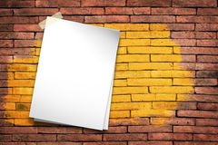 White paper. Stick tape on the gray brick wall stock images