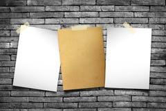 White paper. Notes. Stick tape on the orange brick wall stock illustration
