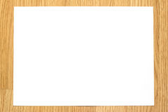 White paper. With wood background stock photo