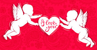 White paper angels with heart - I love you on red background Stock Photo