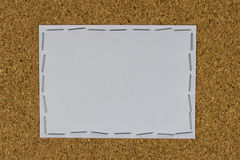 White paper attached on the brown board with stapler Royalty Free Stock Images