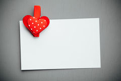 White paper background with red valentine heart clip Royalty Free Stock Photography