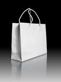 White paper bag on reflect floor Stock Photography