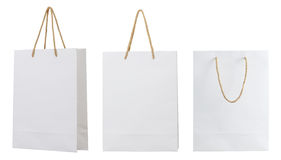 White paper bag. White paper shopping bag with golden hand rope isolated on white background Royalty Free Stock Photos