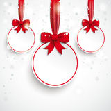 3 White Paper Bauble Red Ribbon Snowfall. Christmas baubles with snowflakes on the white background Royalty Free Stock Photo