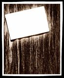 White paper blank on grunge wooden wall with frame border. And empty space for text.Digitally altered image Royalty Free Stock Photo