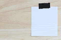 White paper blank or note paper on the brown wooden floor. Stock Photography