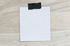 White paper blank or note paper on the brown wooden floor. Royalty Free Stock Photography