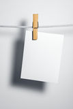 White paper blank on rope Stock Images