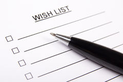 White paper with blank wish list and pen Stock Photos