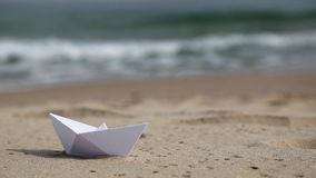White paper boat on the beach stock footage