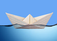 White paper boat floating. stock photos