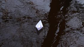 White paper boat that is reflected in the water carries current forwards. White paper boat that is reflected in water carries current forwards stock video footage