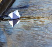White Paper Boat Sailing Stock Photo