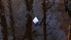 White paper boat sails on the autumn stream. White paper boat sails on autumn stream stock video