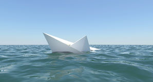 White paper boat is sinking in the sea water Royalty Free Stock Images