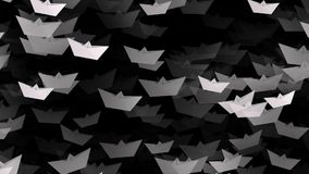 White paper boats on black color stock footage