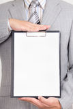 White paper in business man hands Stock Photo