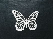 White paper butterfly on a black background Stock Photography