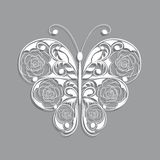 White paper butterfly with floral pattern on gray Royalty Free Stock Images