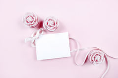 White paper card decorated with pink bow and rose scented candle Stock Photo