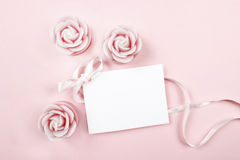 White paper card decorated with pink bow and rose scented candle Stock Image