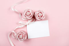White paper card decorated with pink bow and rose scented candle Stock Images