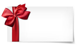 White paper card with gift red satin bow. Stock Photos
