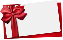 White paper card with gift red satin bow. Royalty Free Stock Photos
